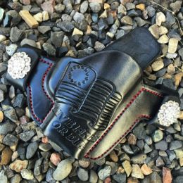 Live Free or Die Hand-Tooled OWB Holster by Soteria Leather